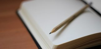 A note with a pencil on top